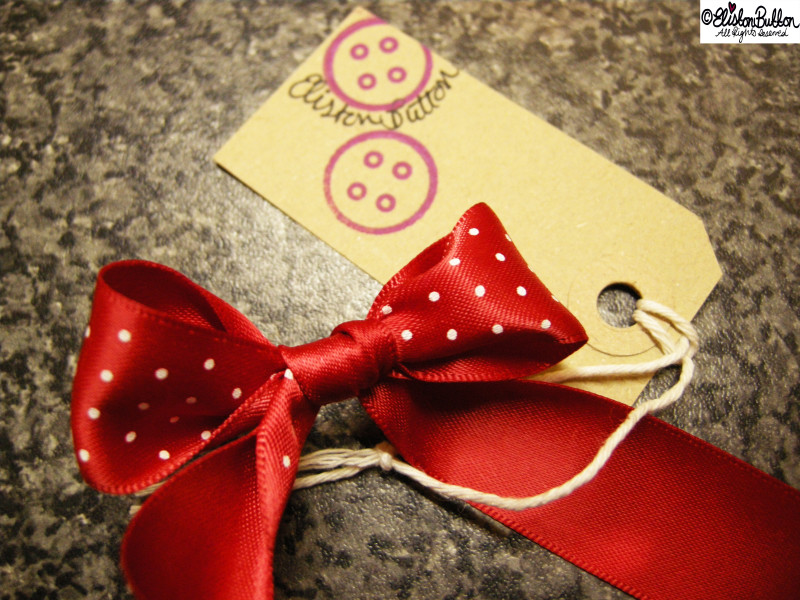 Red Polka Dot Ribbon Bow and Eliston Button Logo - Quilted Christmas Baubles - A Tutorial at www.elistonbutton.com - Eliston Button - That Crafty Kid – Art, Design, Craft & Adventure.