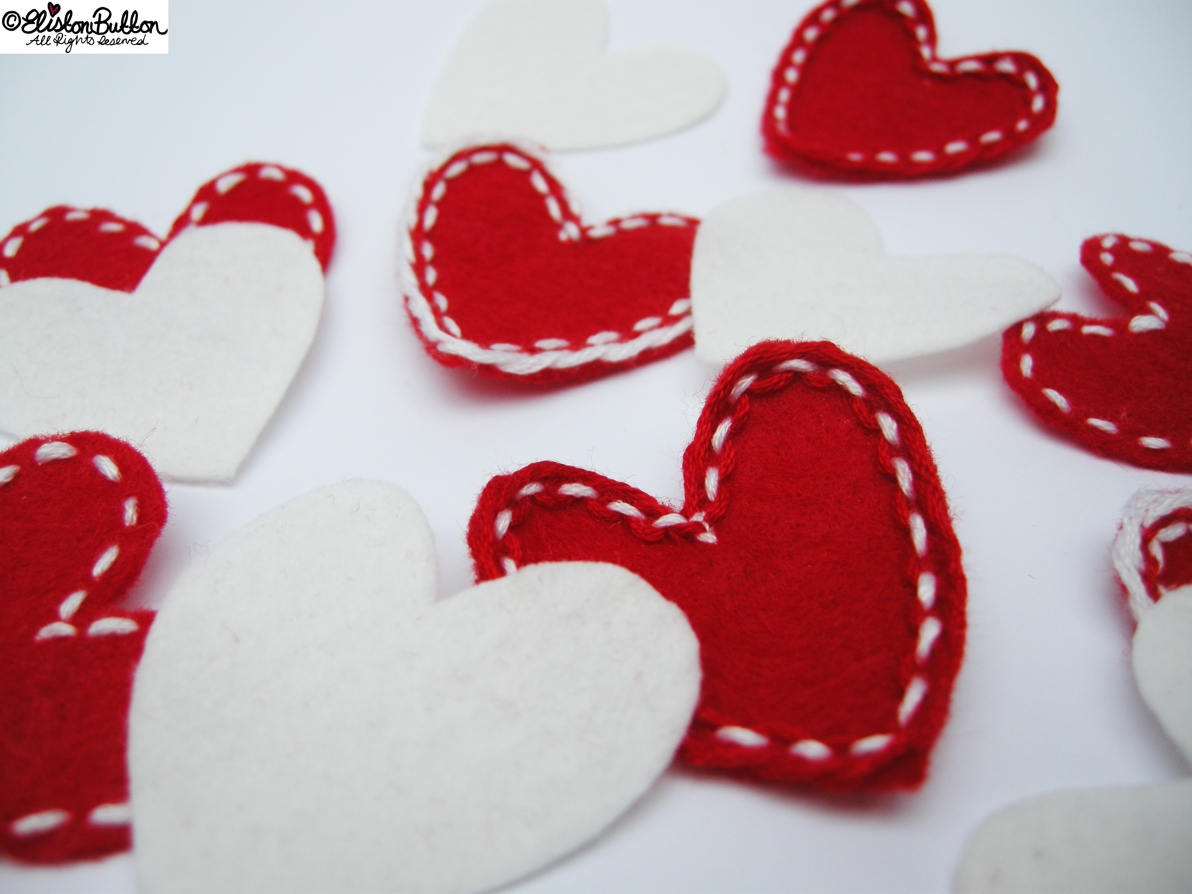 Close Up of Embroidered Felt Hearts - Workspace Wednesday - I Give You My Heart at www.elistonbutton.com - Eliston Button - That Crafty Kid – Art, Design, Craft & Adventure.