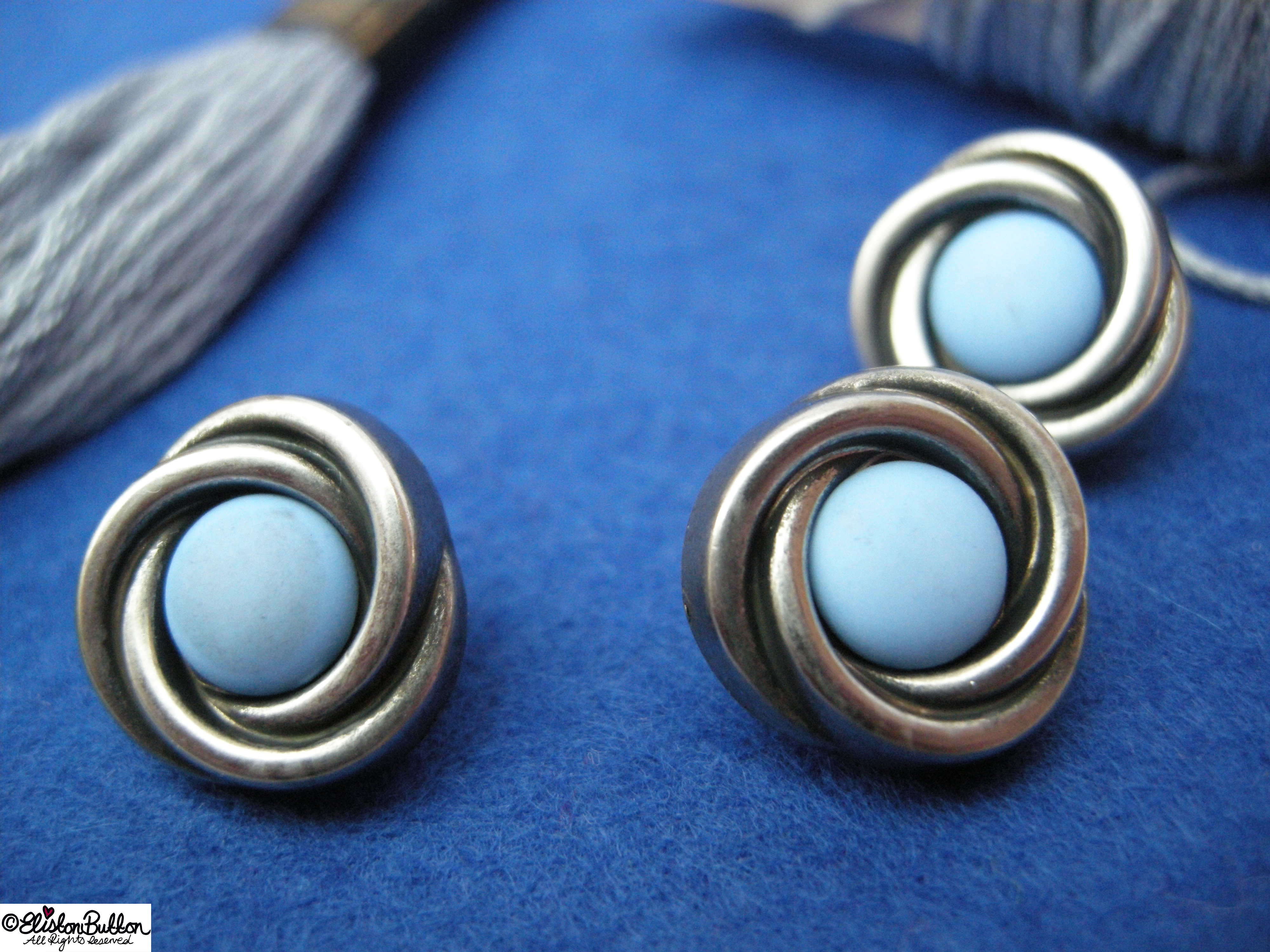 Art Deco Swirl Buttons and Blue Felt  - 27 Before 27 - Out of the Blue at www.elistonbutton.com - Eliston Button - That Crafty Kid – Art, Design, Craft & Adventure.