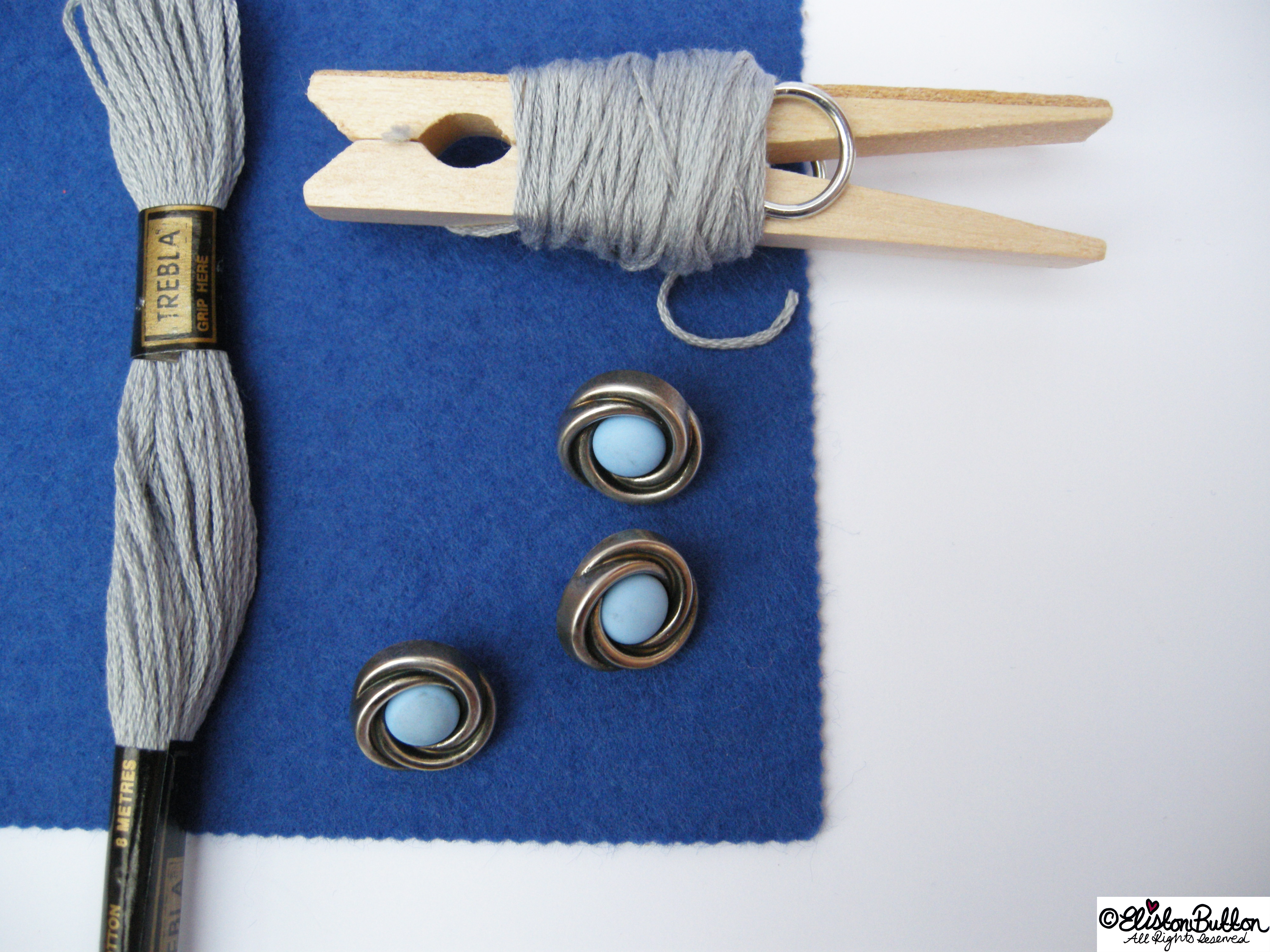 Art Deco Swirl Buttons and Blue Felt with Silver Grey Embroidery Thread - 27 Before 27 - Out of the Blue at www.elistonbutton.com - Eliston Button - That Crafty Kid – Art, Design, Craft & Adventure.
