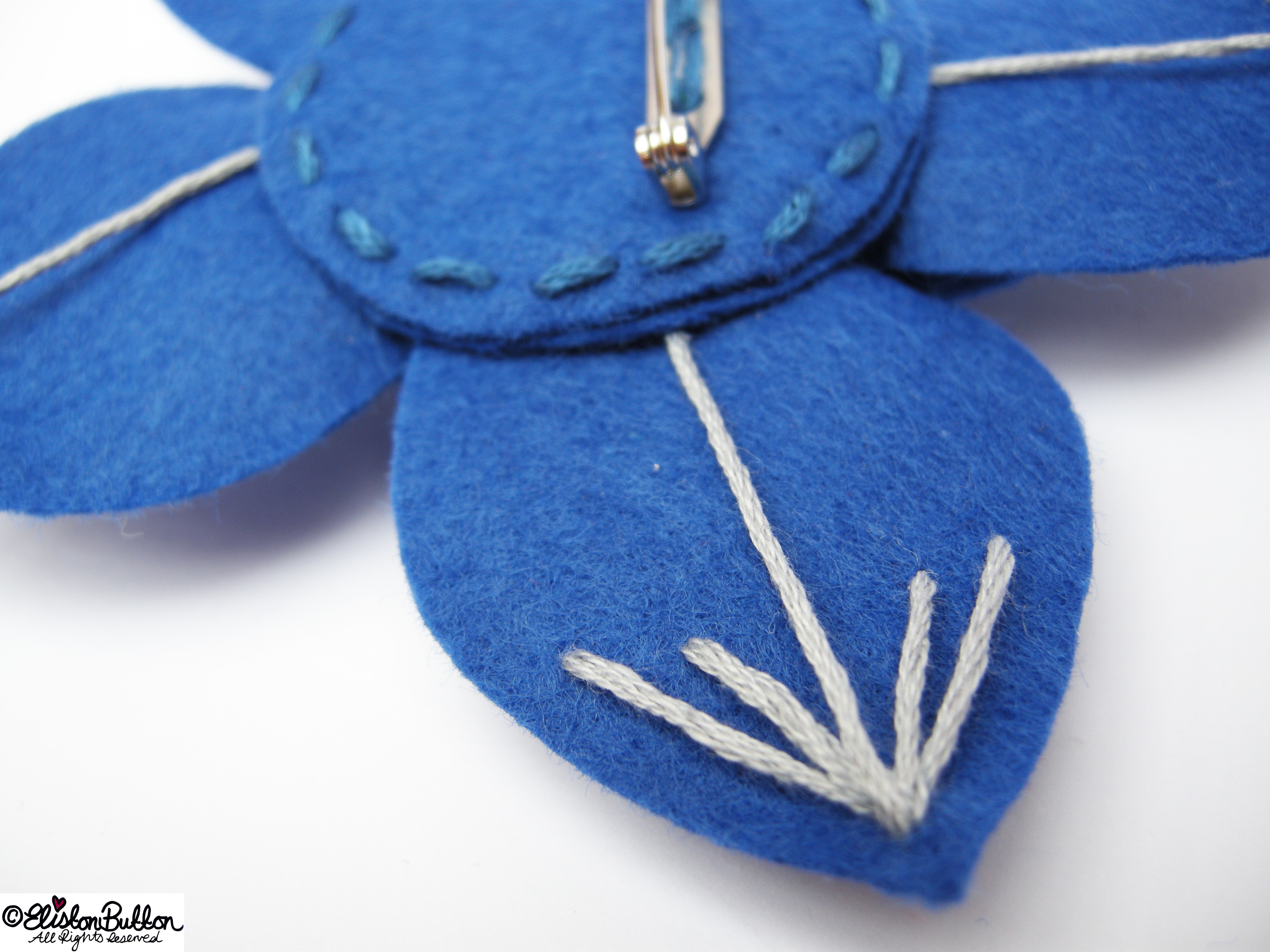 Out of the Blue Embroidered Felt Flower Brooch - Back Detail - 27 Before 27 - Out of the Blue at www.elistonbutton.com - Eliston Button - That Crafty Kid – Art, Design, Craft & Adventure. t of the Blue' – Number 6 in the '27 Before 27' blog challenge at www.elistonbutton.com - Eliston Button - That Crafty Kid