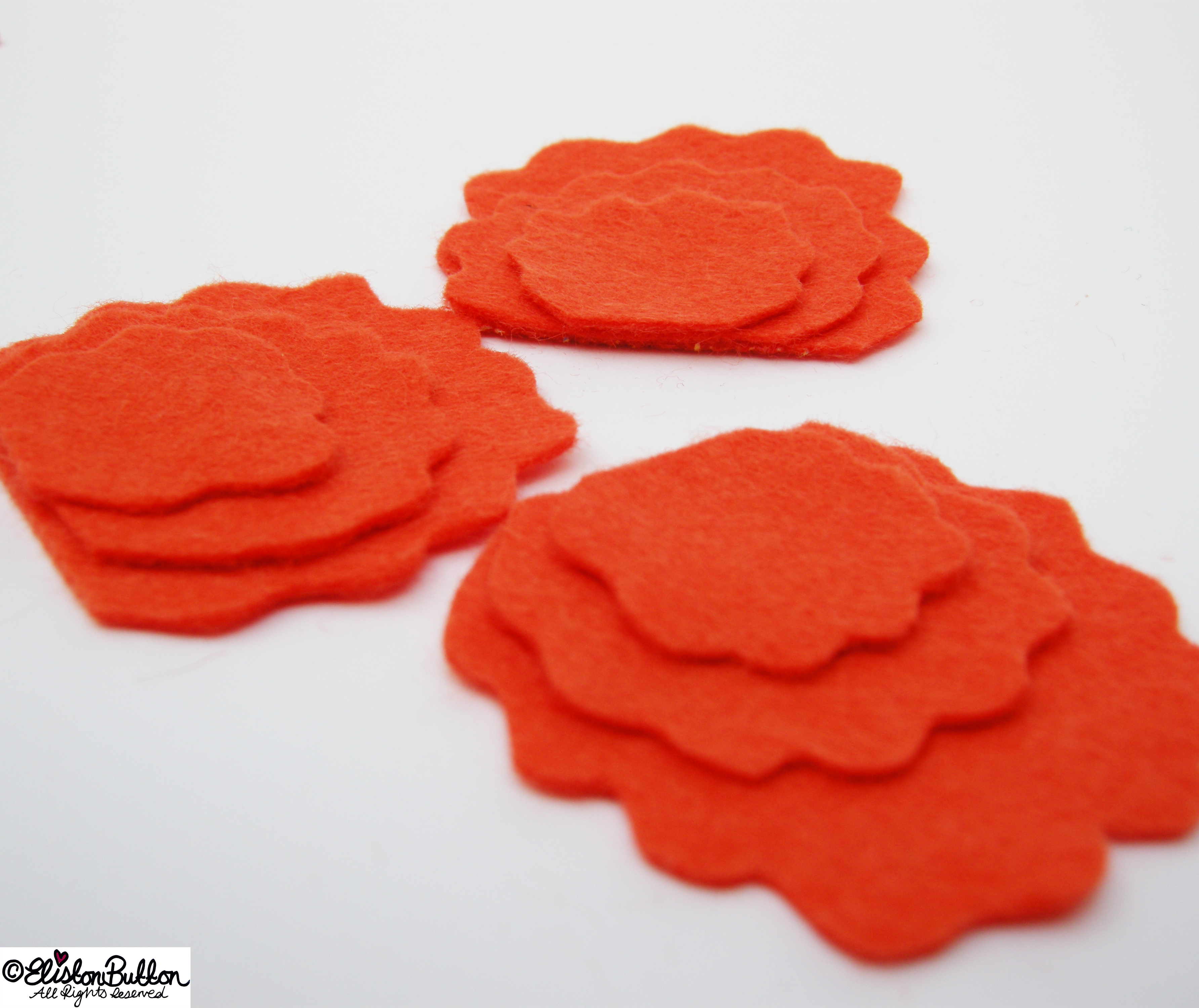 Scallop Shaped Felt Petals Stacked for Sewing - 27 before 27 - Tangerine at www.elistonbutton.com - Eliston Button - That Crafty Kid – Art, Design, Craft & Adventure.
