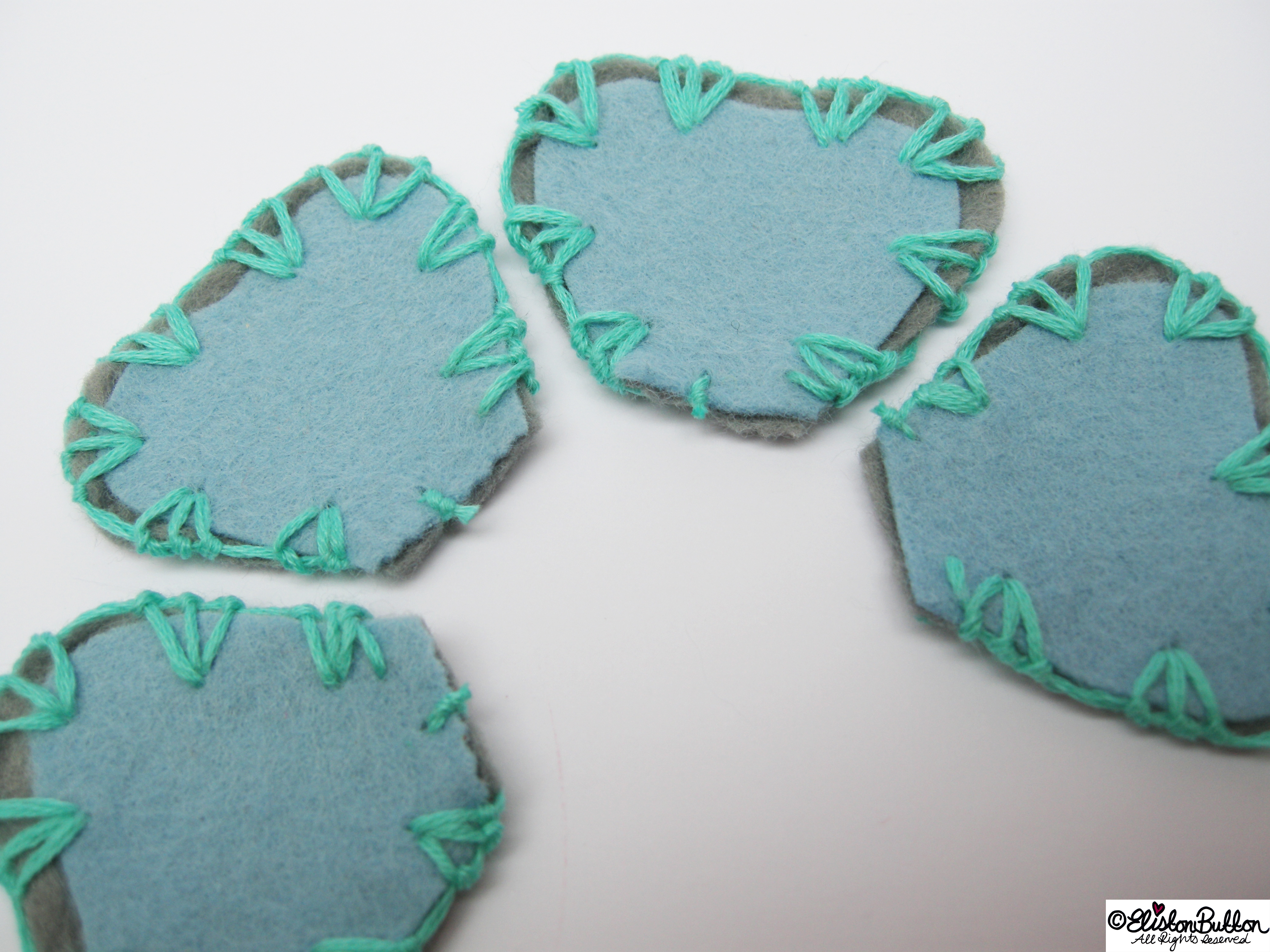Pastel Blue and Grey Felt Petal Shapes Embroidered with Turquoise Embroidery Thread  - All Together - 27 Before 27 – Aquamarine at www.elistonbutton.com - Eliston Button - That Crafty Kid – Art, Design, Craft & Adventure.
