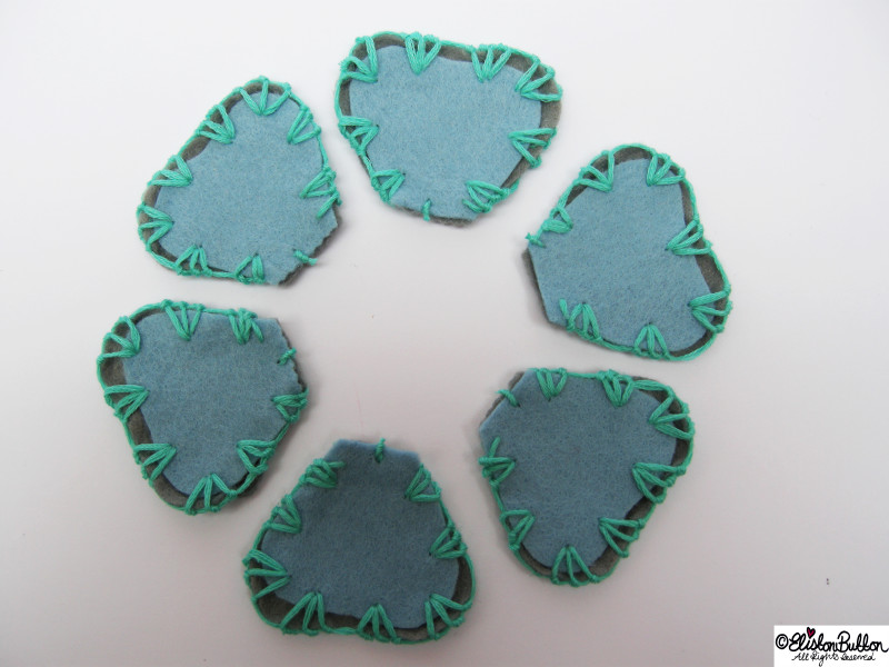 Pastel Blue and Grey Felt Petal Shapes Embroidered with Turquoise Embroidery Thread - Organising Shapes - 27 Before 27 – Aquamarine at www.elistonbutton.com - Eliston Button - That Crafty Kid – Art, Design, Craft & Adventure.