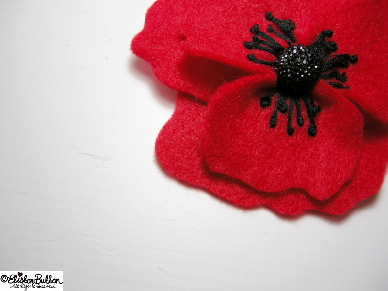Embroidered Red Felt Poppy Flower Brooch Detail - 27 Before 27 – Poppy at www.elistonbutton.com - Eliston Button - That Crafty Kid – Art, Design, Craft & Adventure.
