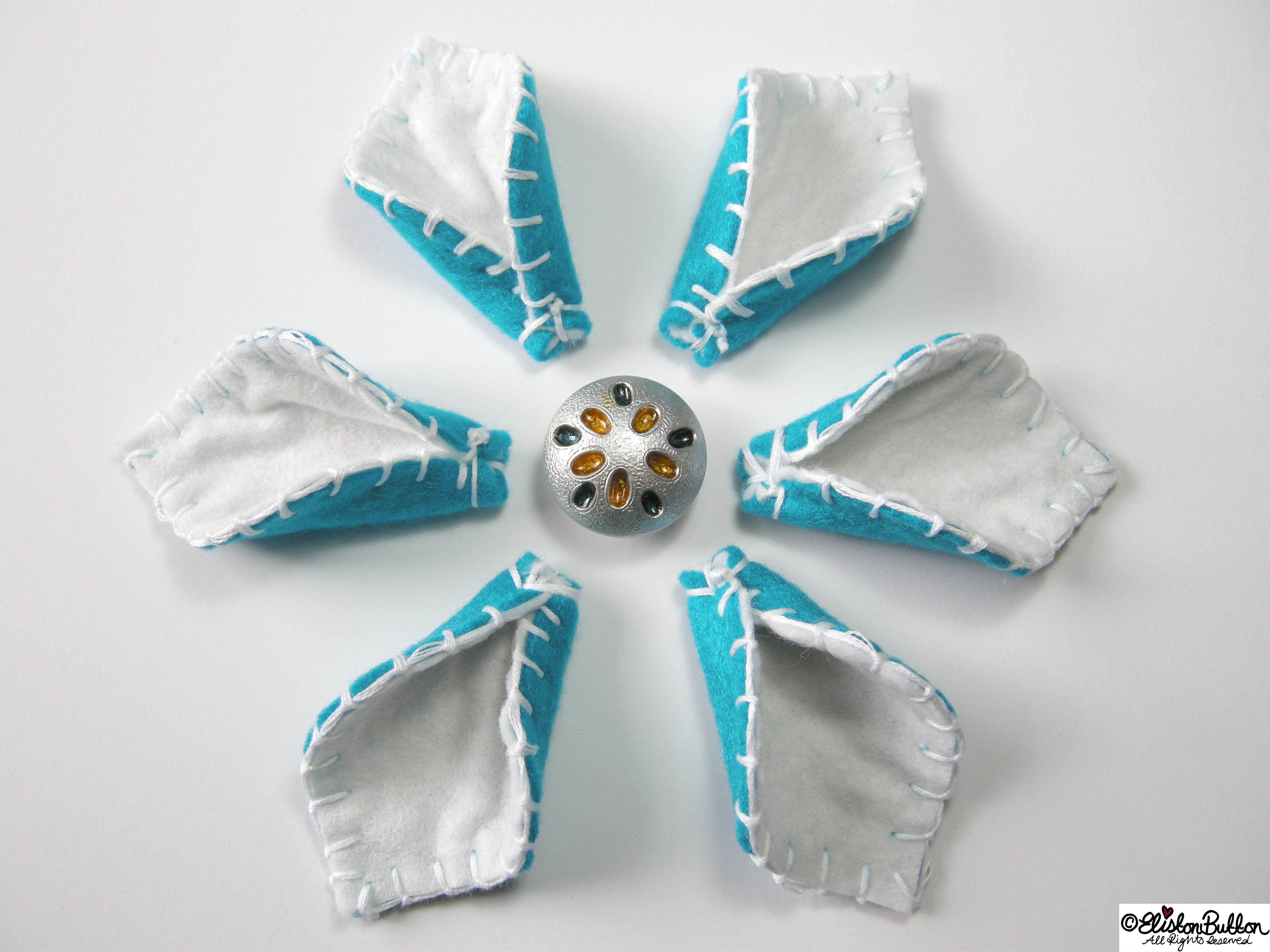 Peppermint Turquoise Felt Flower Petals with Blanket Stitch Embroidery and Silver Metal Button Centrepiece - 27 Before 27 – Peppermint at www.elistonbutton.com - Eliston Button - That Crafty Kid – Art, Design, Craft & Adventure.