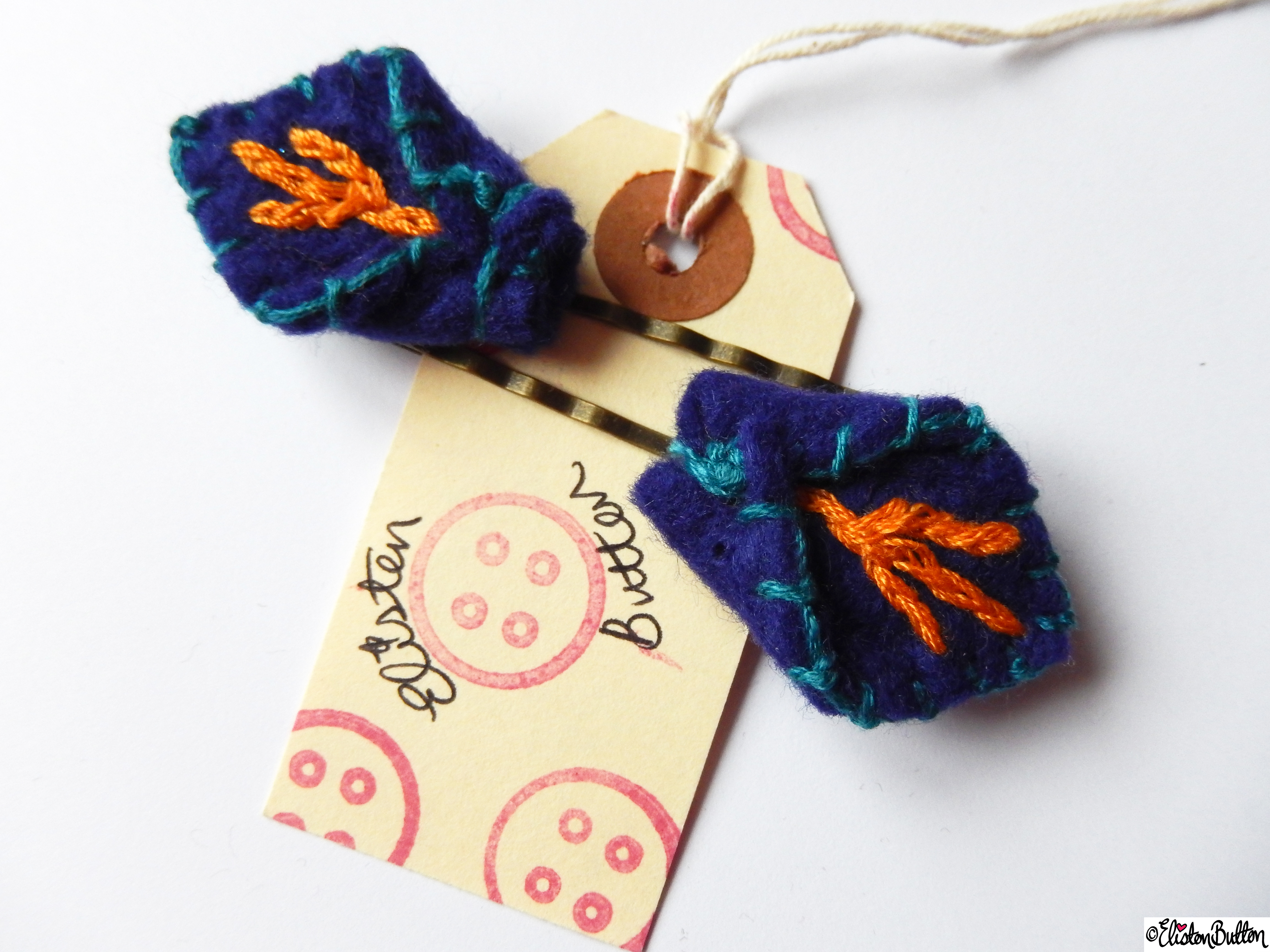 Blue, Turquoise and Orange Embroidered Felt Petal Hair Grips on Branded Luggage Tag - Create 28 - No.4 - Embroidered Felt Petal Hair Grips at www.elistonbutton.com - Eliston Button - That Crafty Kid – Art, Design, Craft & Adventure.