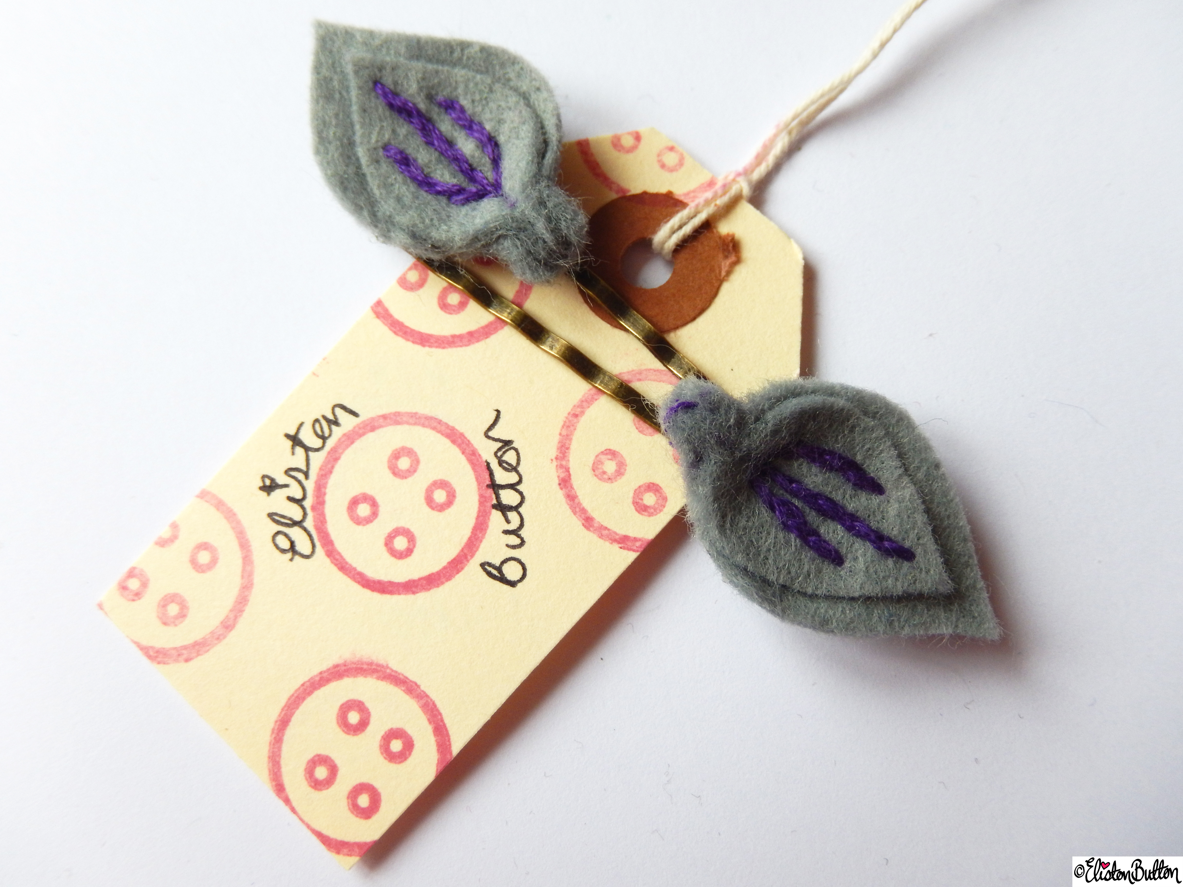 Slate Grey and Purple Berry Embroidered Felt Hair Grips on Branded Luggage Tag - Create 28 - No.4 - Embroidered Felt Petal Hair Grips at www.elistonbutton.com - Eliston Button - That Crafty Kid – Art, Design, Craft & Adventure.