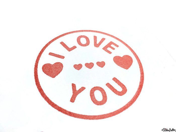 Close Up of I Love You and Hearts Stamped Image on a Simple Red and White I Love You, Hearts and Arrow Hand Stamped Square Card - Love is on the Cards! at www.elistonbutton.com - Eliston Button - That Crafty Kid – Art, Design, Craft & Adventure.