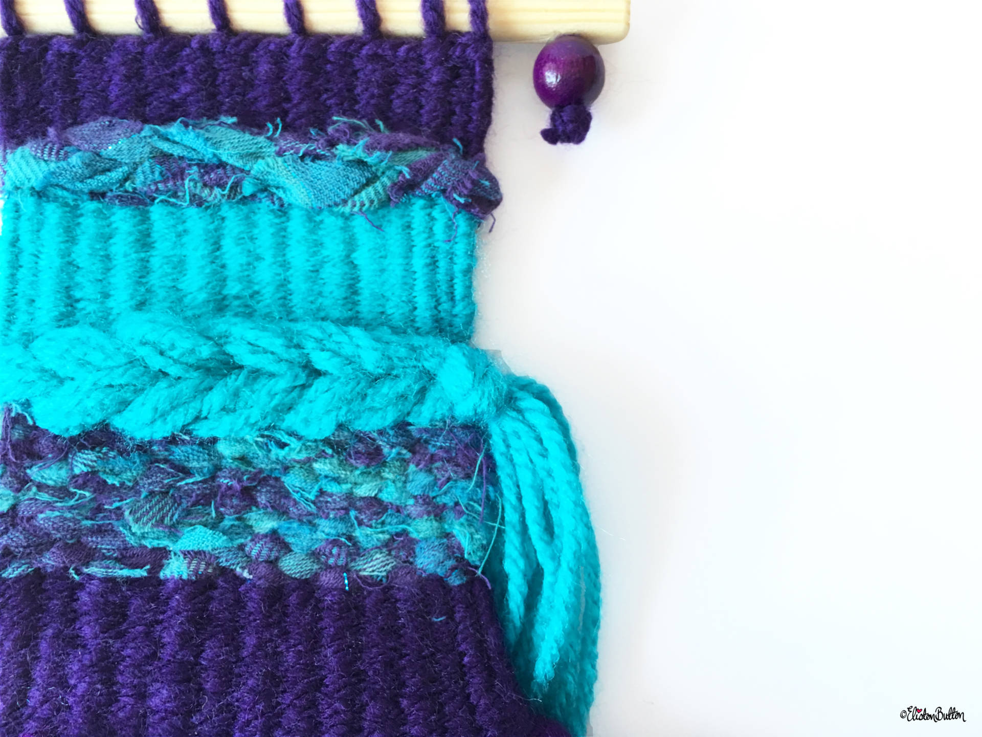 Purple and Turquoise Mini Woven Wall Hanging Close up with Bead and Wooden Dowel - Create 30 - No.2 - Mini Woven Wall Hangings at www.elistonbutton.com - Eliston Button - That Crafty Kid – Art, Design, Craft & Adventure.