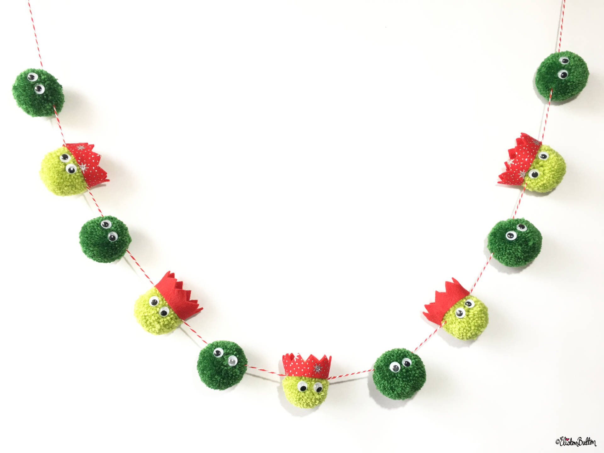 christmas sprout pom pom garland by eliston button create 30 no 8