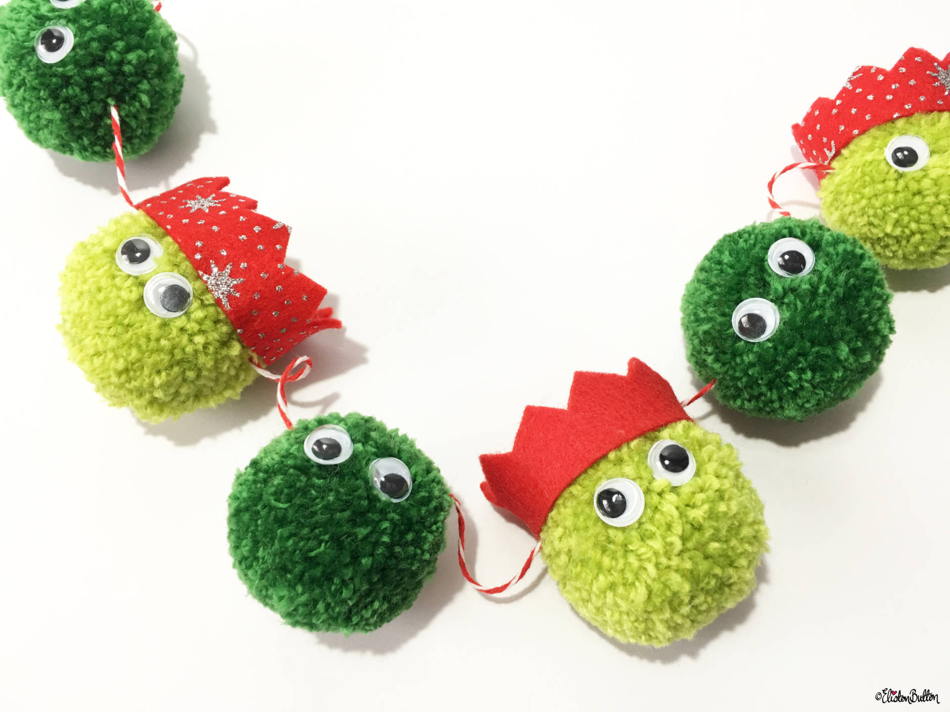 christmas sprout pom pom garland in party hats by eliston button create 30 no