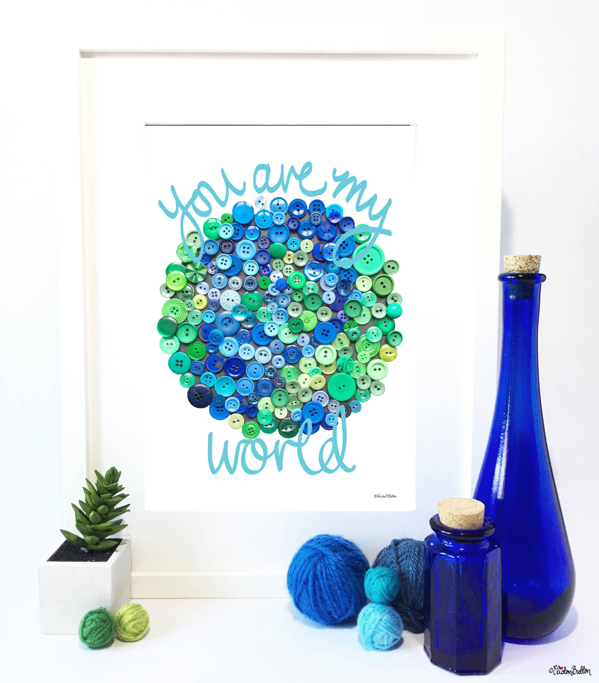 Blue You are My World Print in Frame with Blue Glass Blottles, Succulents and Yarn Props - Blue You are My World Print in Frame with Blue Glass Blottles, Succulents and Yarn Props - Create 30 - No. 13 - 'You Are My World' Button Art Quote Prints at www.elistonbutton.com - Eliston Button - That Crafty Kid – Art, Design, Craft & Adventure.
