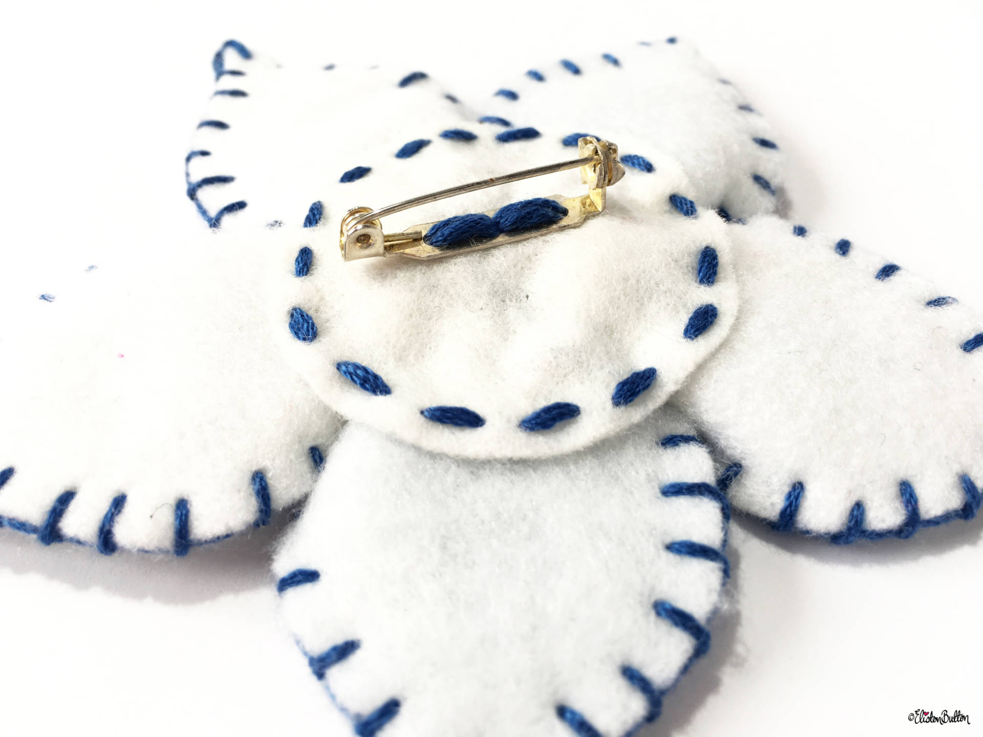 Blue and White Embroidered Felt Flower Brooch by Eliston Button Safety Catch Brooch Back with Neat Stitching - Create 30 - No. 14 - Blue and White Embroidered Felt Flower Brooch at www.elistonbutton.com - Eliston Button - That Crafty Kid – Art, Design, Craft & Adventure.