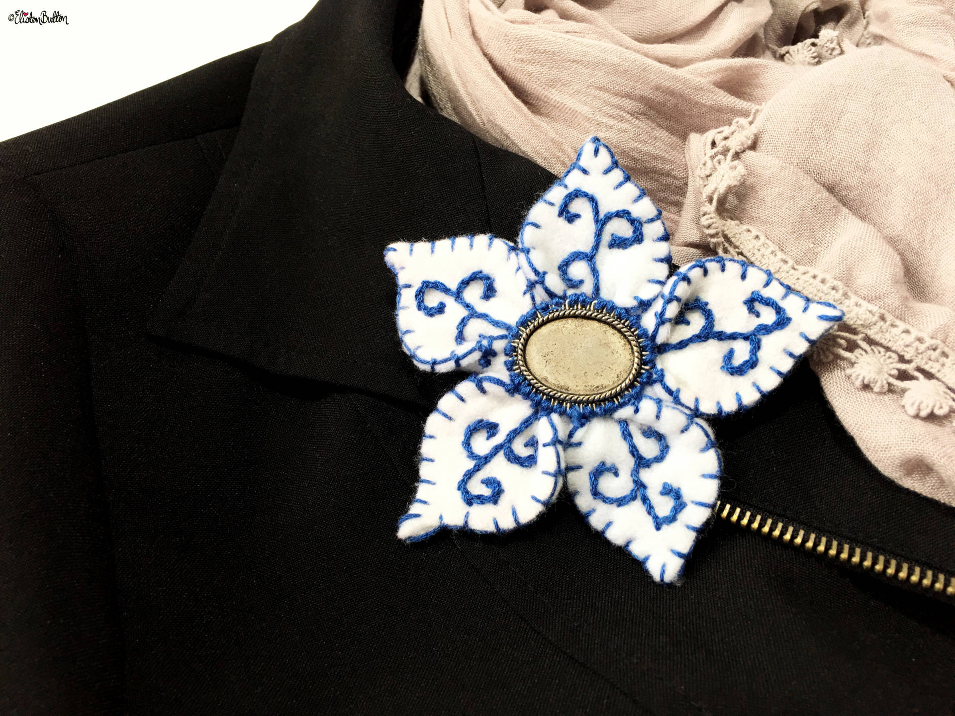 Blue and White Embroidered Felt Flower Brooch on Black Jacket Lapel with a Grey Scarf by Eliston Button - Blue and White Embroidered Felt Flower Brooch on a Black Jacket Lapel with a Grey Scarf by Eliston Button - Create 30 - No. 14 - Blue and White Embroidered Felt Flower Brooch at www.elistonbutton.com - Eliston Button - That Crafty Kid – Art, Design, Craft & Adventure.