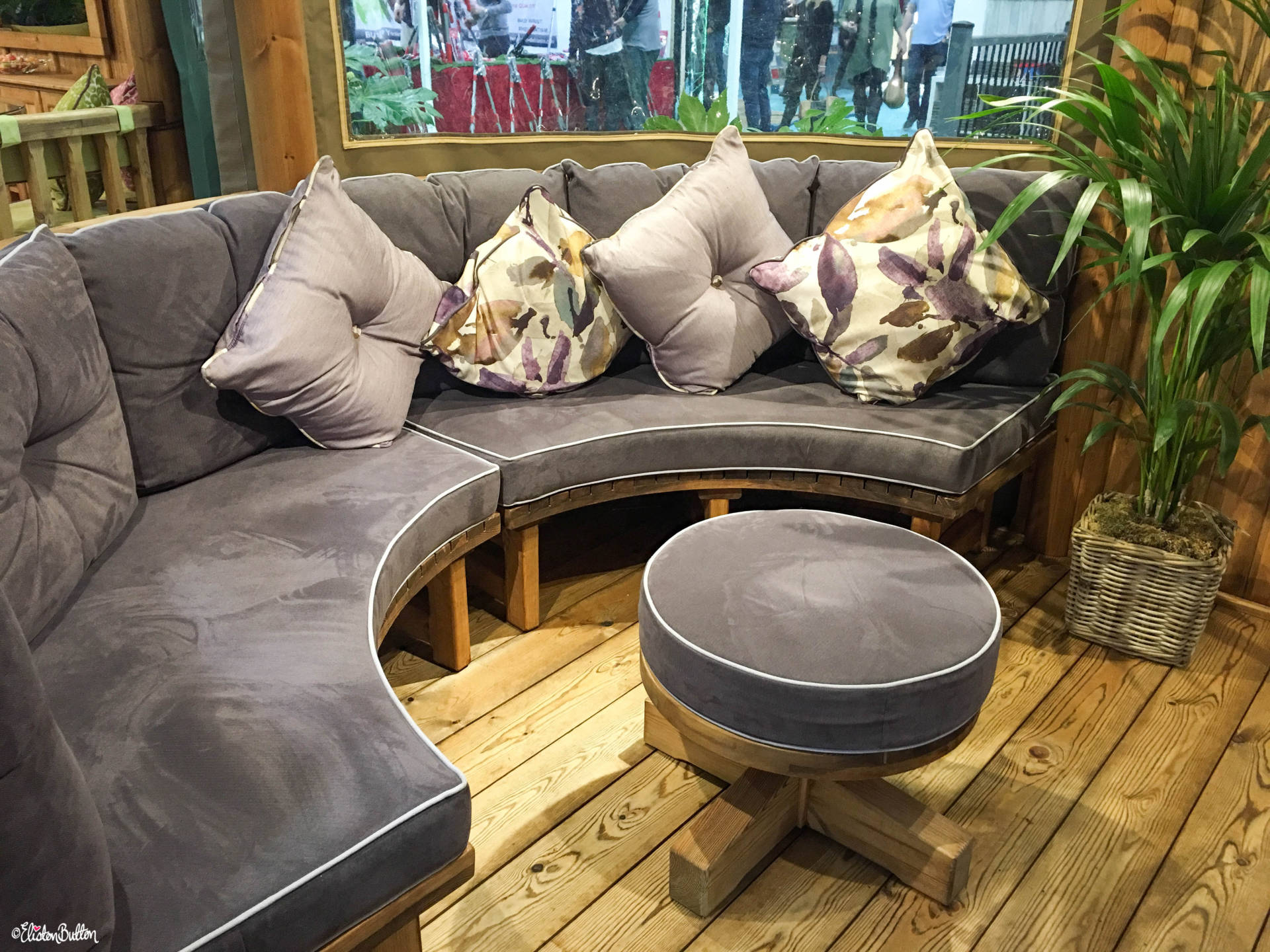 Beautiful Grey Plush Cushion Seating in a Breeze House Luxury Thatched Garden Room at Grand Designs Live 2017 with Eliston Button - Grand Designs Live 2017 – Part Two at www.elistonbutton.com - Eliston Button - That Crafty Kid – Art, Design, Craft & Adventure.