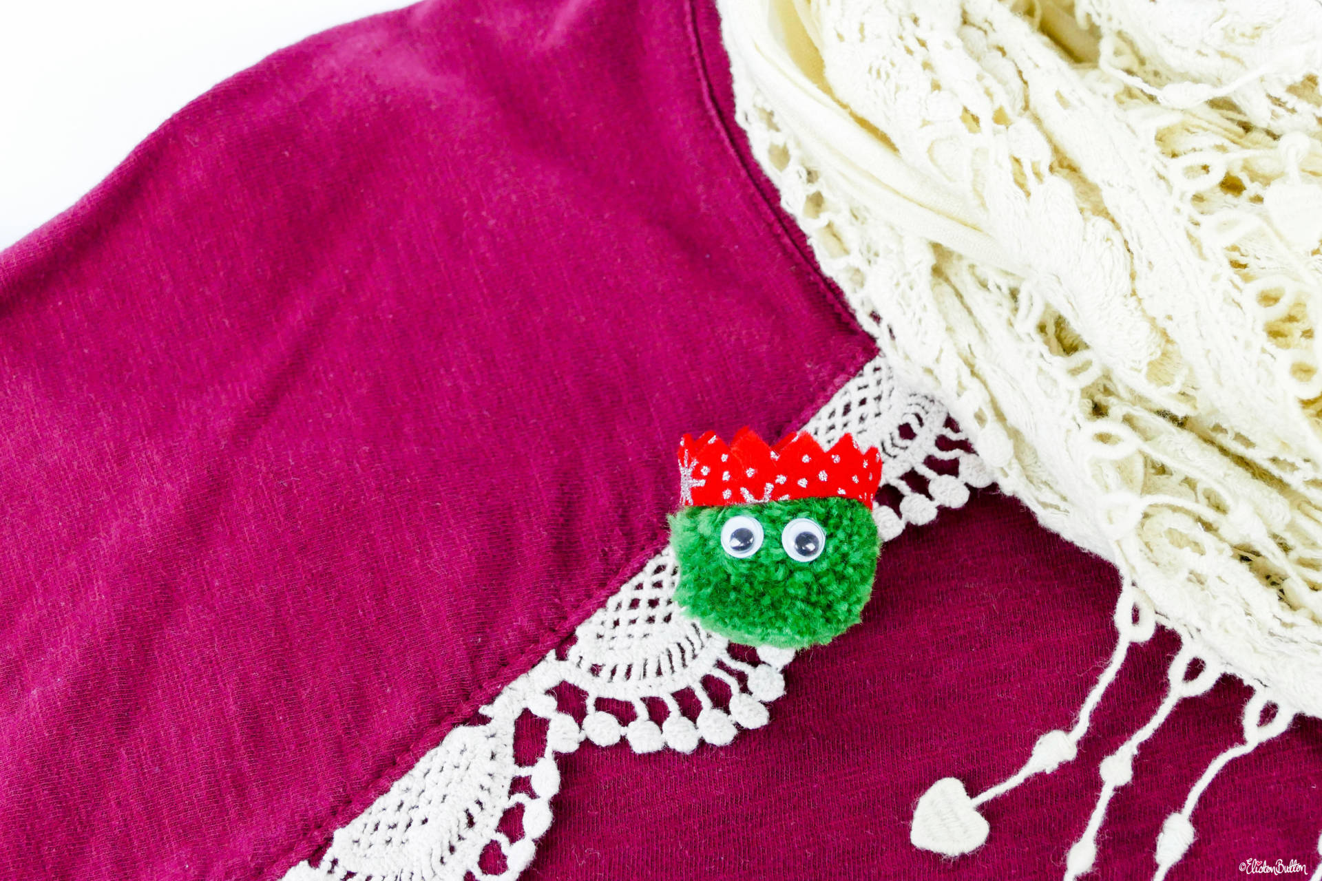 Dark Green Christmas Sprout Pom Pom Brooch on a Christmas Jumper with Red Glitter Party Hat by Eliston Button - Christmas Sprout Pom Pom Brooches! at www.elistonbutton.com - Eliston Button - That Crafty Kid – Art, Design, Craft & Adventure.