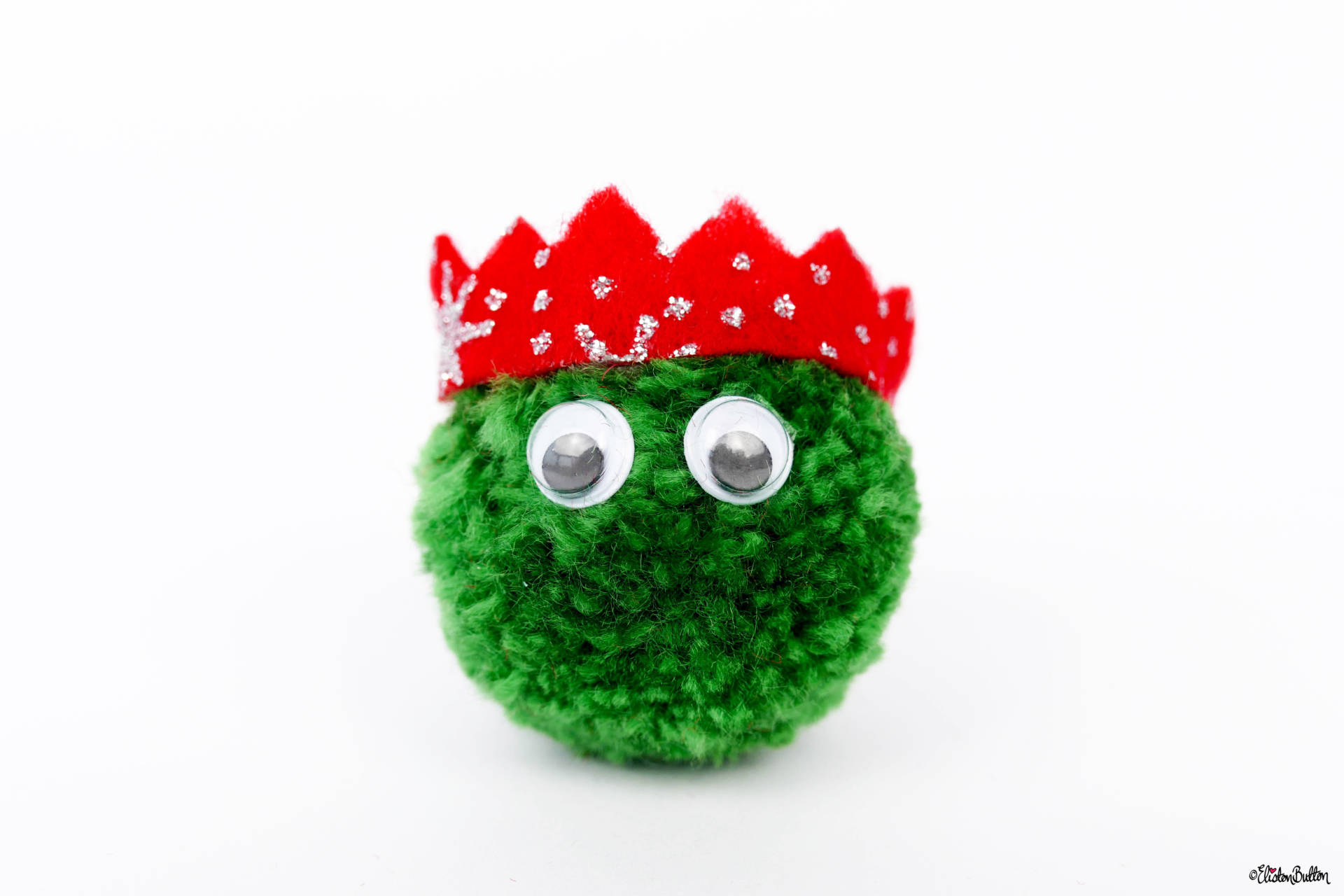 Dark Green Christmas Sprout Pom Pom Brooch with Red Glitter Party Hat by Eliston Button - Christmas Sprout Pom Pom Brooches! at www.elistonbutton.com - Eliston Button - That Crafty Kid – Art, Design, Craft & Adventure.