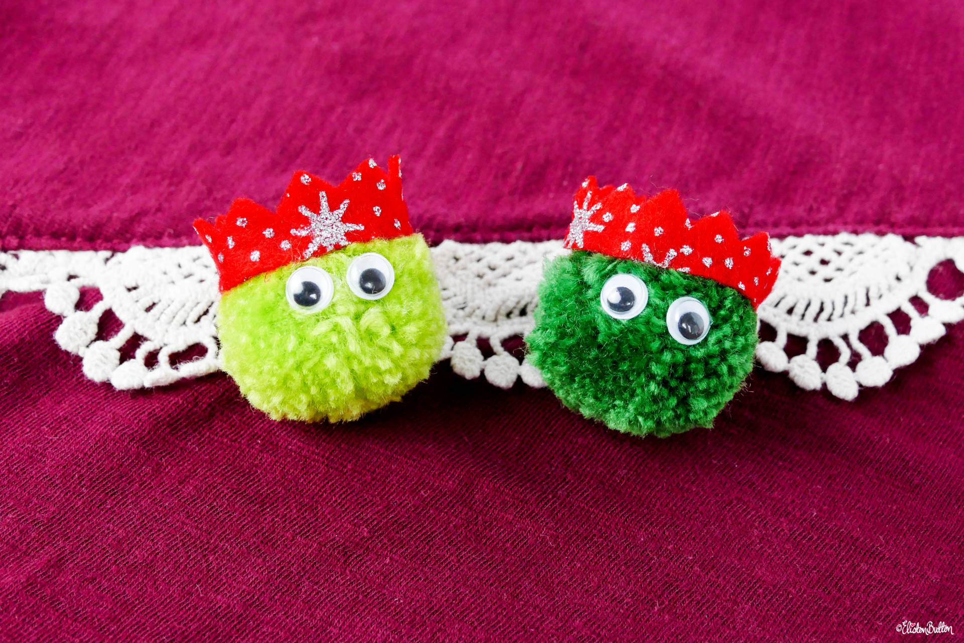 Dark and Light Green Christmas Sprout Pom Pom Brooches with Red Glitter Party Hats by Eliston Button - Christmas Sprout Pom Pom Brooches! at www.elistonbutton.com - Eliston Button - That Crafty Kid – Art, Design, Craft & Adventure.