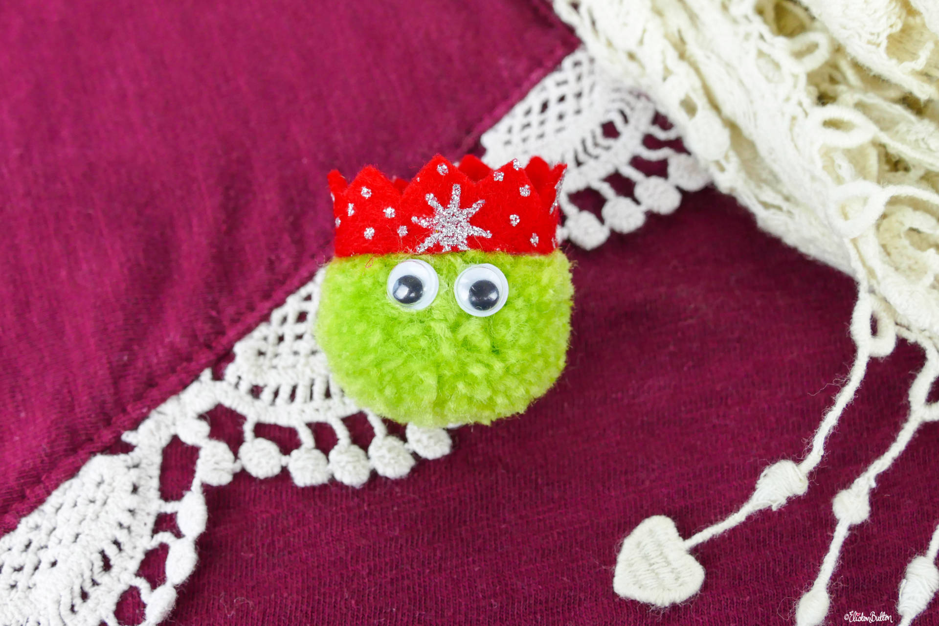Light Green Christmas Sprout Pom Pom Brooch with Red Glitter Party Hat on a Christmas Jumper by Eliston Button - Christmas Sprout Pom Pom Brooches! at www.elistonbutton.com - Eliston Button - That Crafty Kid – Art, Design, Craft & Adventure.