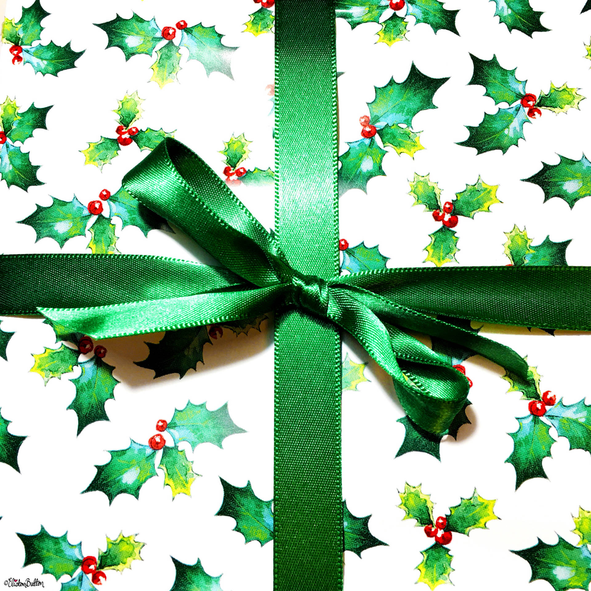 Vintage Holly and Berry Illustrated Wrapping Paper Tied with a Green Ribbon Bow - For the Love of…Christmas at www.elistonbutton.com - Eliston Button - That Crafty Kid – Art, Design, Craft & Adventure.